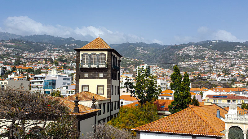 The Sacred Art Museum of Funchal stands against the backdrop of the city.