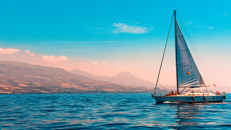 Sailboat on the water with mountains in the background